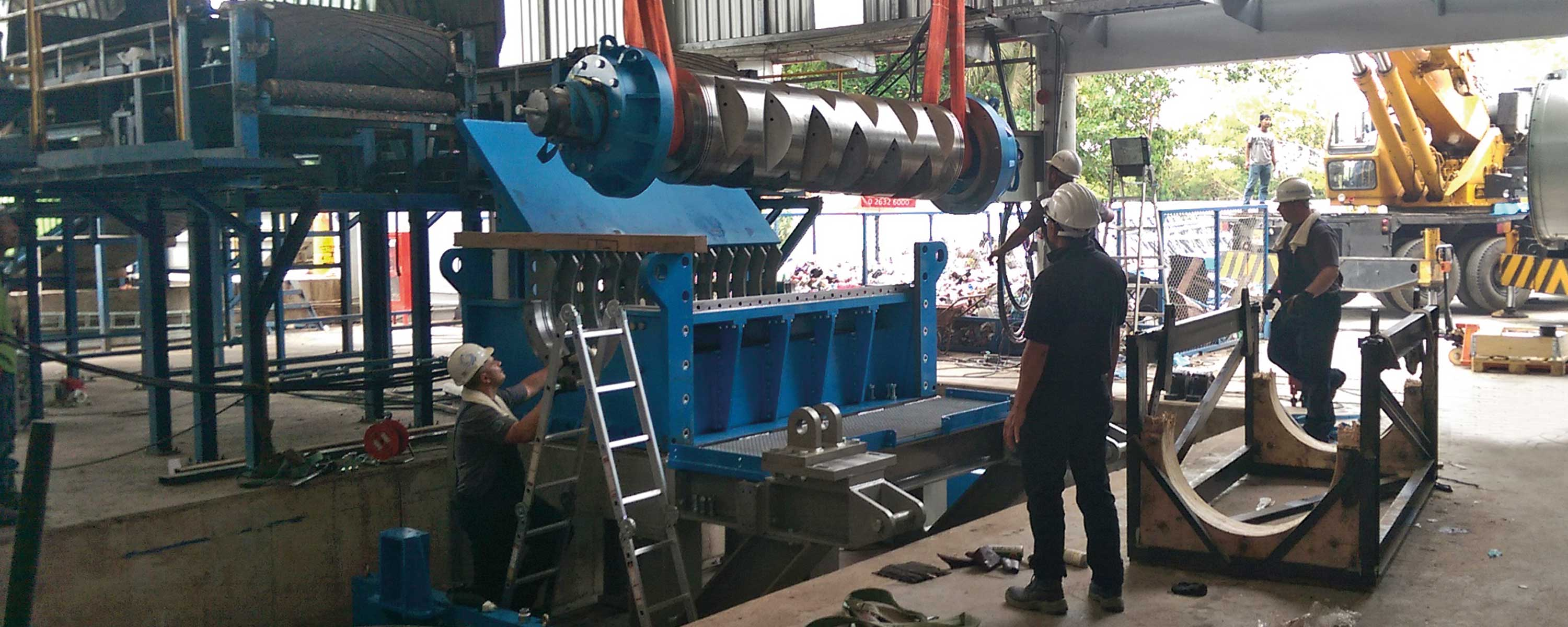 Shaft being lowered into a recycling machine